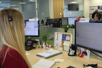 Lyndsey at her desk