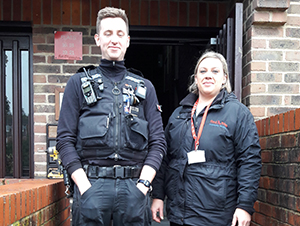 A police officer and Red Kite staff standing outside of McLellan Place