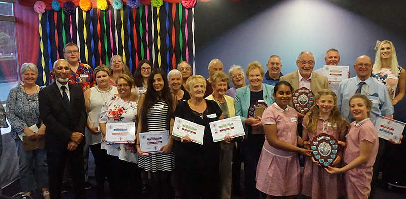 Neighbourhood Award winners standing for a group shot